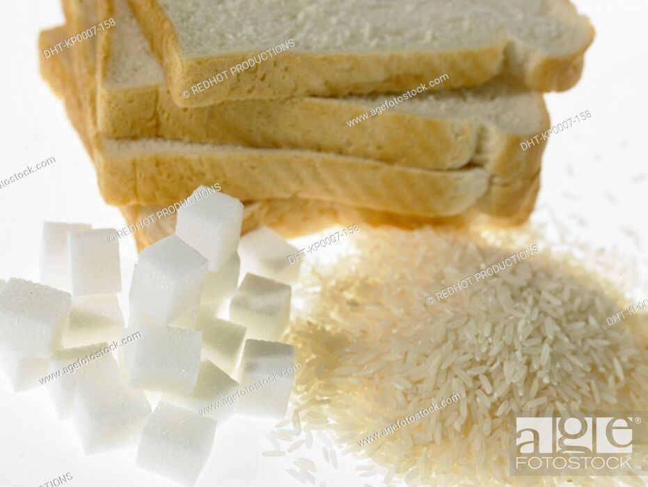 Imagen: Stack of White Bread slices beside piles of sugar and rice.