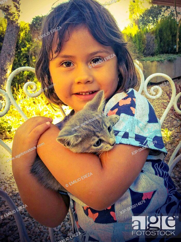 Stock Photo: Little girl with kitten.
