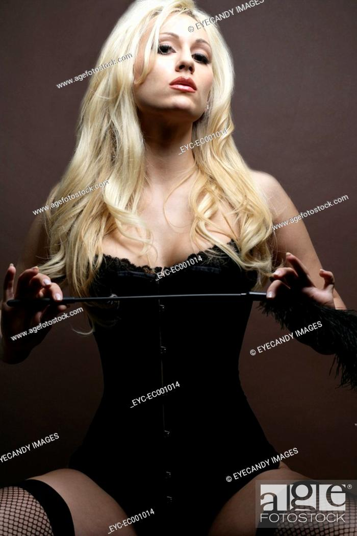 Stock Photo: Portrait of a woman sitting in lingerie.