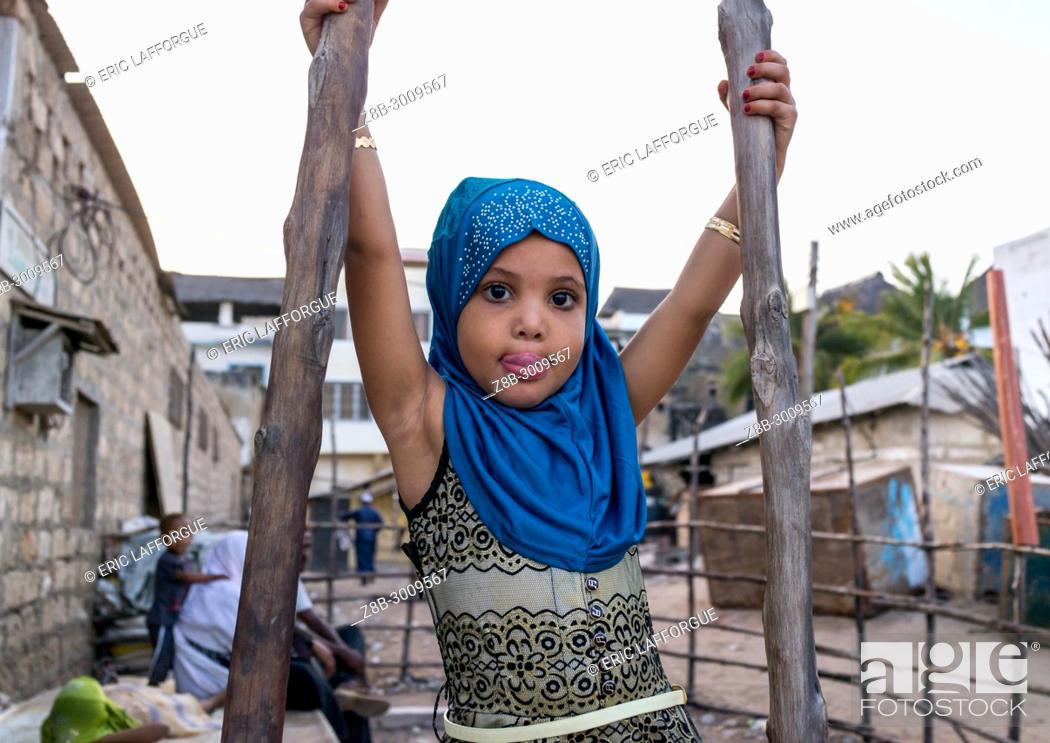 Stock Photo: Young girl dressed with a blue veil, Lamu County, Lamu Town, Kenya.