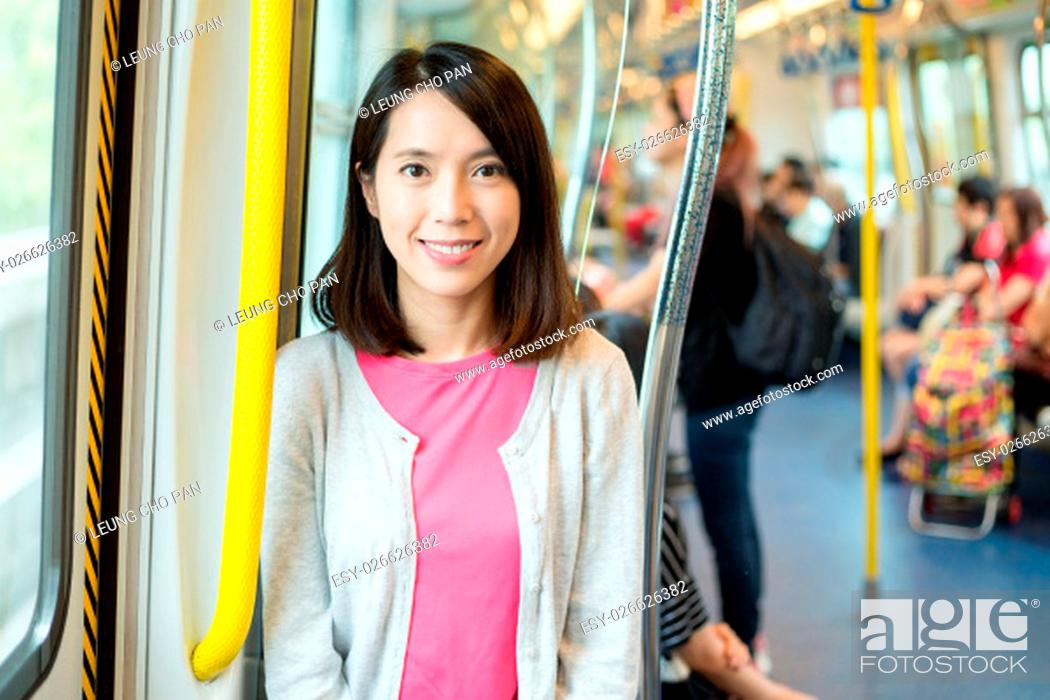 Stock Photo: Asian woman inside train compartment.