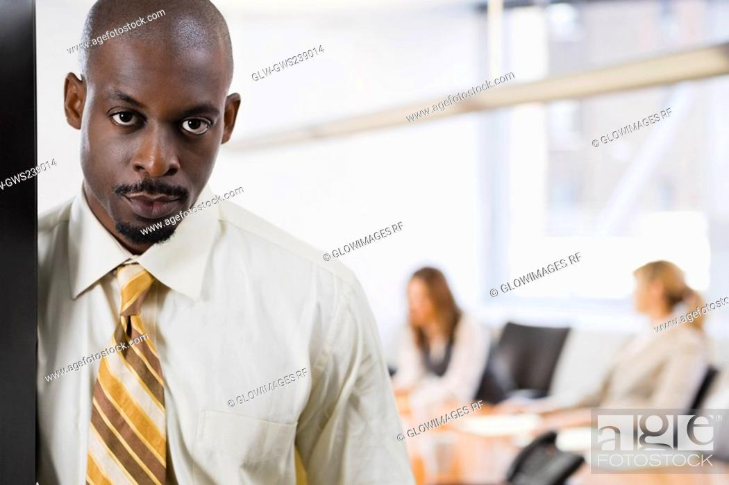Stock Photo: Portrait of a businessman looking serious.