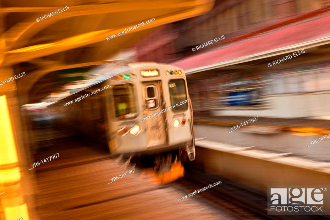 Stock Photo: A train in the Chicago rapid transit system known as the'L' arrives in a station in the LOOP in Chicago, IL, USA.