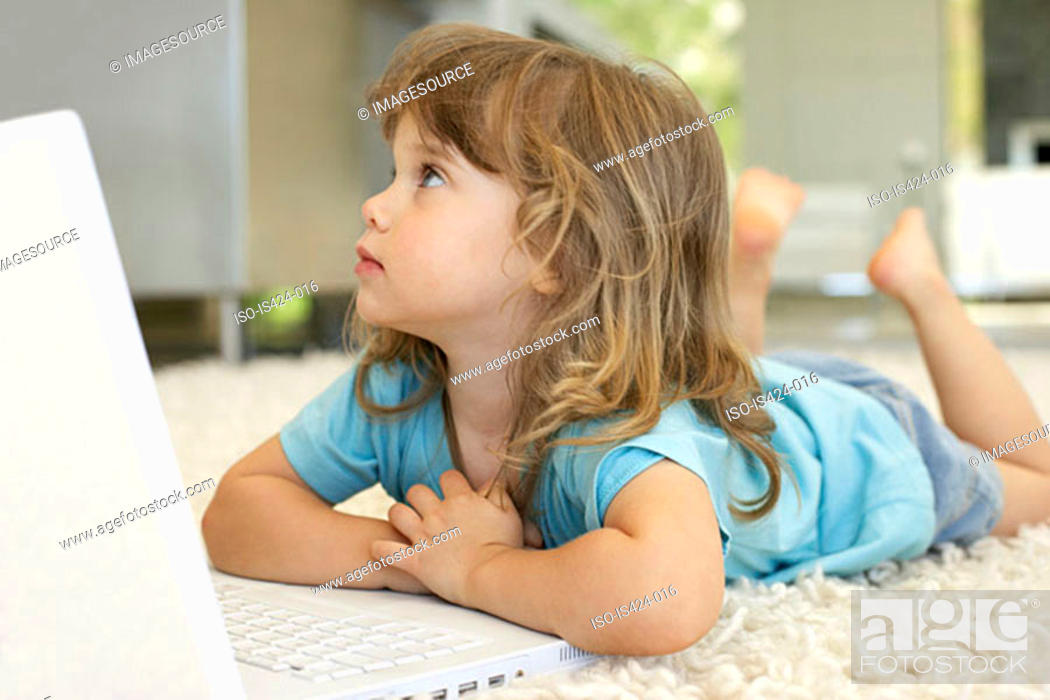 Stock Photo: Young girl using laptop computer.
