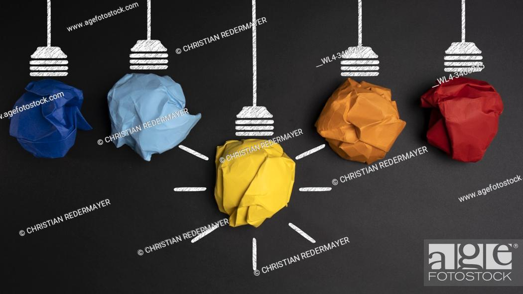 Stock Photo: Develpoing a new idea with 5 coloured paper light bulbs.