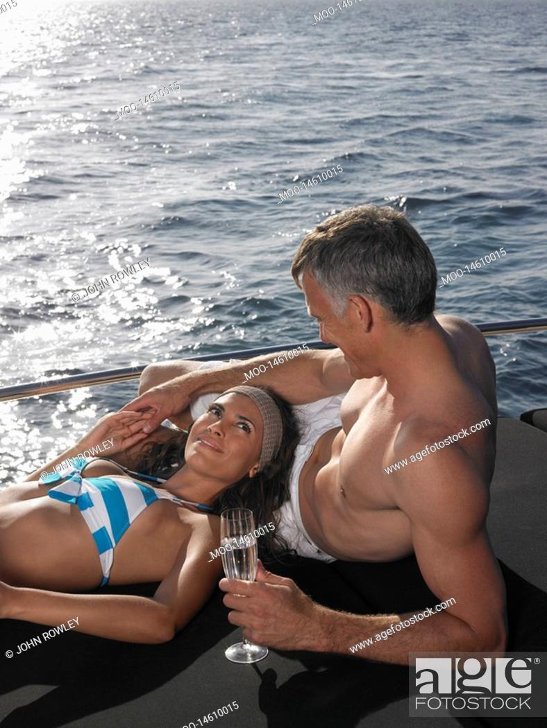 Stock Photo: Couple Sunbathing on Boat.