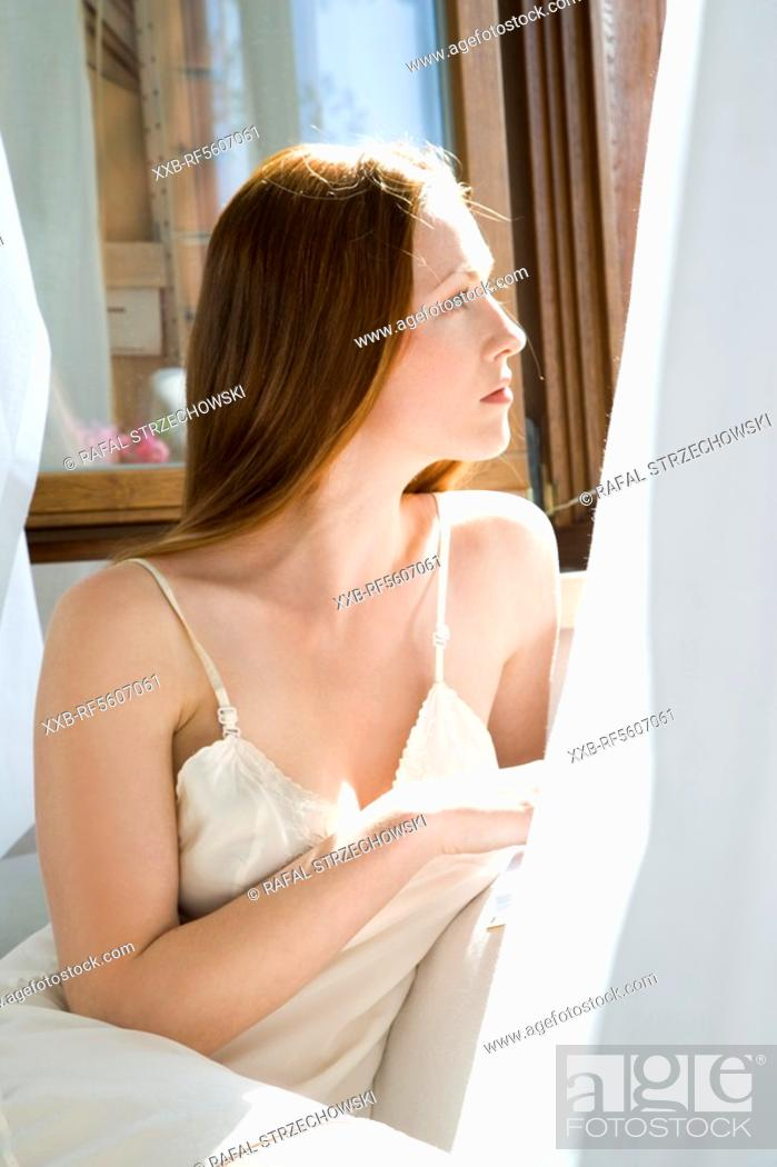Stock Photo: woman reading a book.