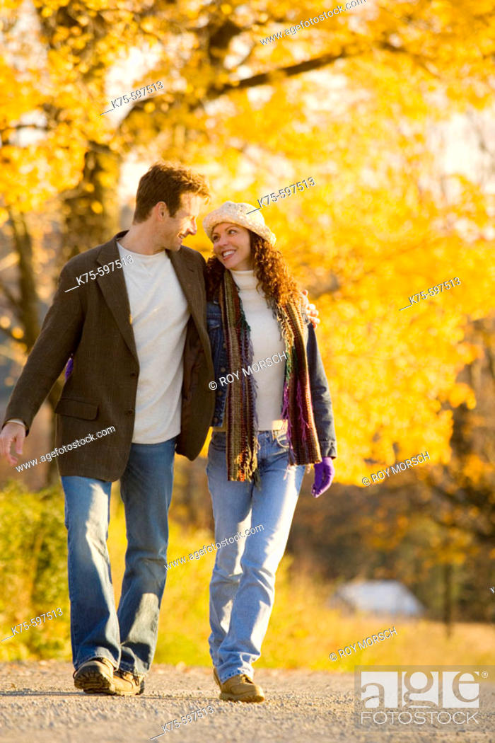 Stock Photo: Couple smiling and walking country road.