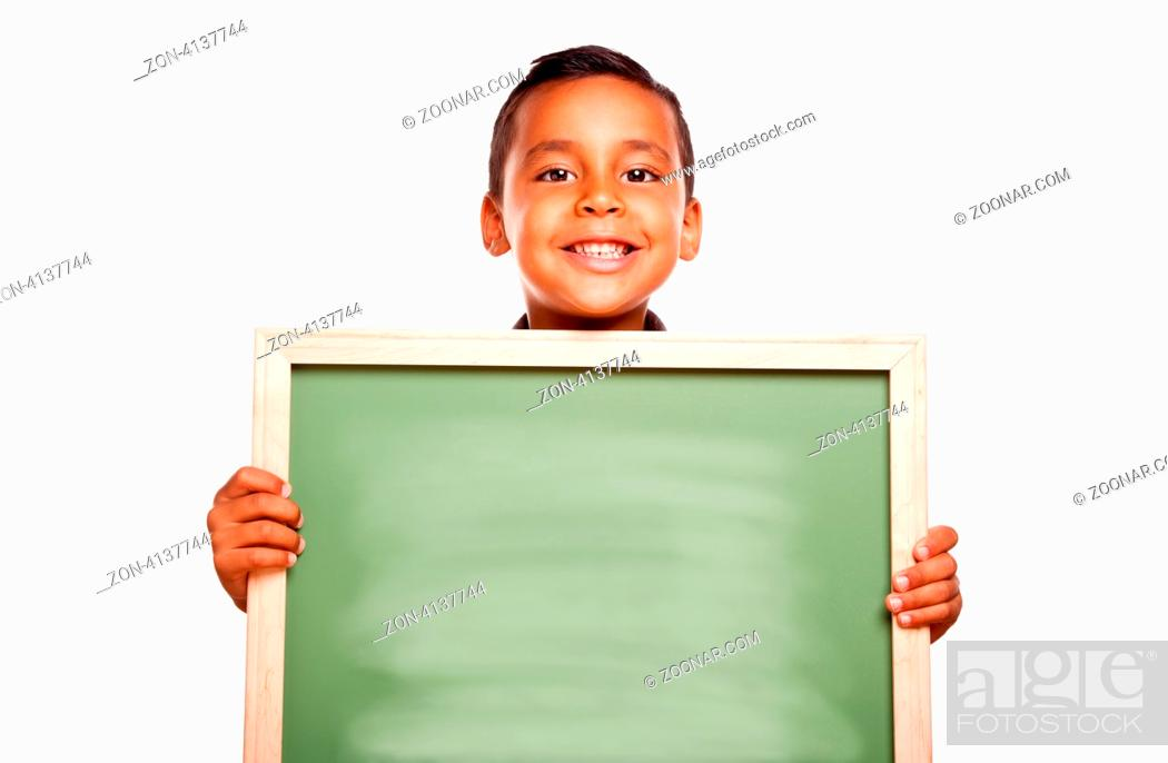 Imagen: Cute Hispanic Boy Holding Blank Chalkboard Ready for Your Own Message Isolated on a White Background.