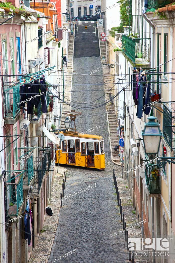 Stock Photo: Bica funicular crossing the Travessa do Sequeiro street, Chiado district, Lisbon, Portugal.