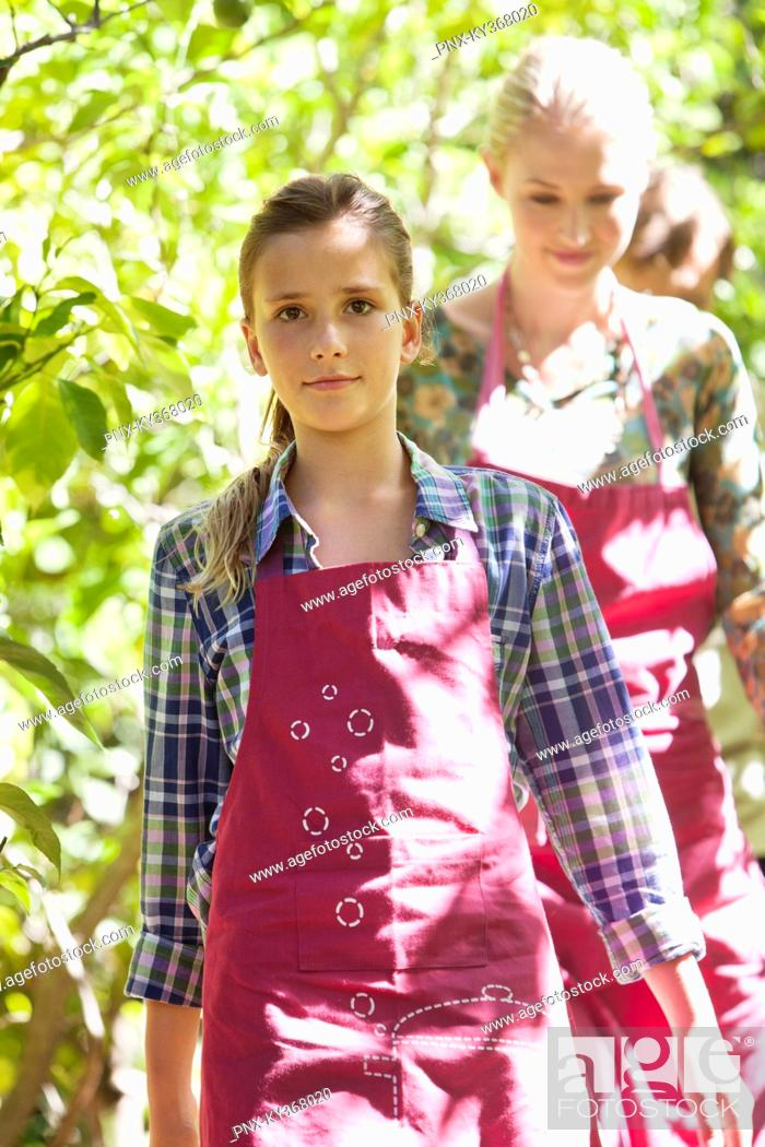 Stock Photo: Woman and girl walking in a garden.