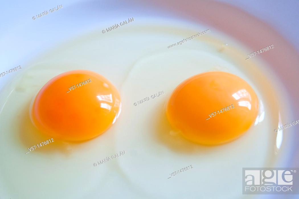 Stock Photo: Two yolks in a dish.