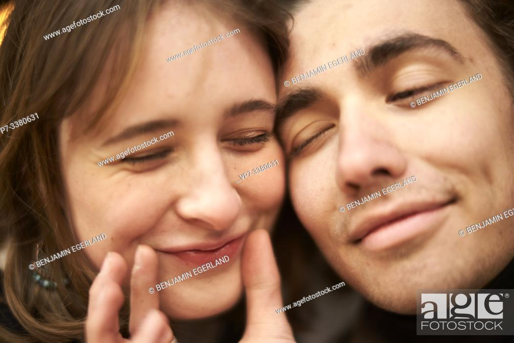 Stock Photo: affectionate man putting a smile on face of woman.