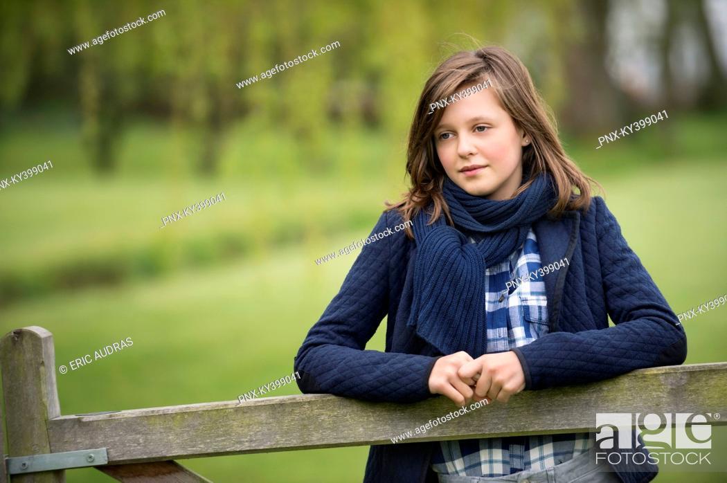 Stock Photo: Girl thinking in a farm.