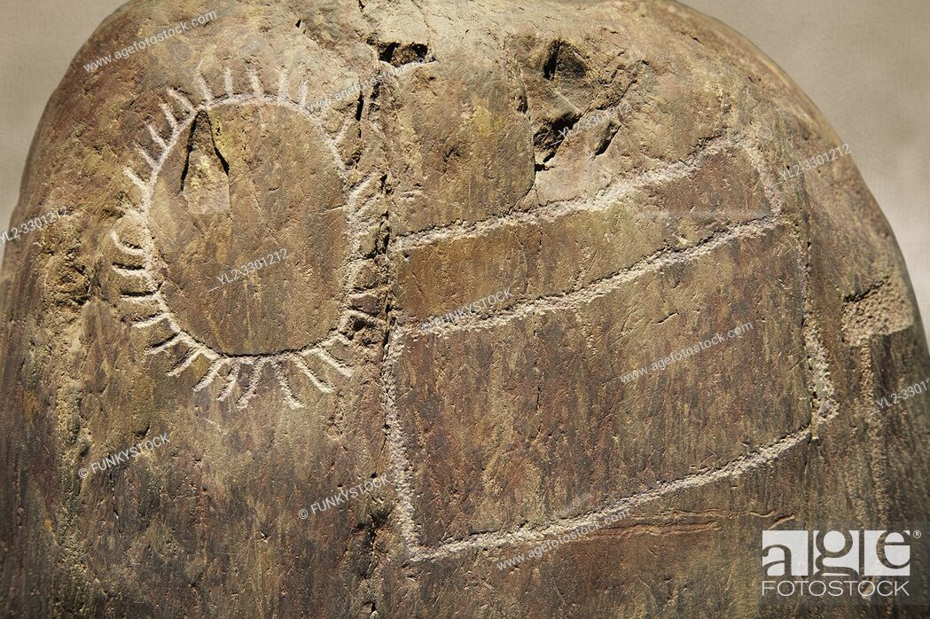 Stock Photo: Prehistoric petroglyphs, rock carvings, carved by the the prehistoric Camuni people in the Copper Age around the 3rd milleneum BC.
