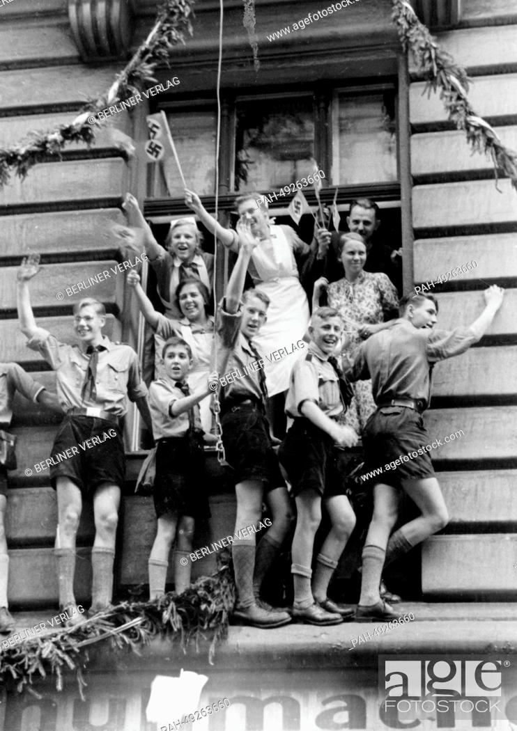 Stock Photo: People cheer at Hitler's victory procession outside of the new Reichs Chancellery on Wilhelmplatz as Hitler returns from his Felsennest headquarters after the.