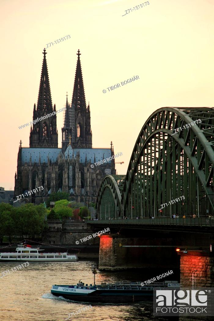 Stock Photo: Cathedral & Hohenzollern bridge at sunset, Cologne, North Rhineland-Westphalia, Germany.