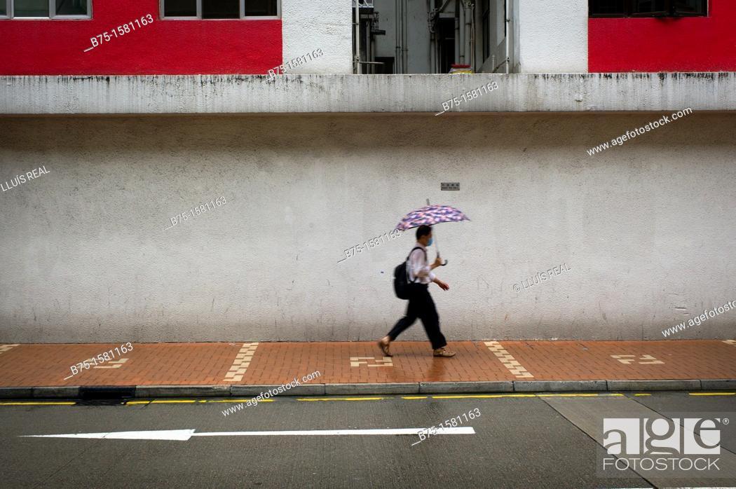 Stock Photo: Person, Man, with umbrella, Hong Kong, China, Asia.