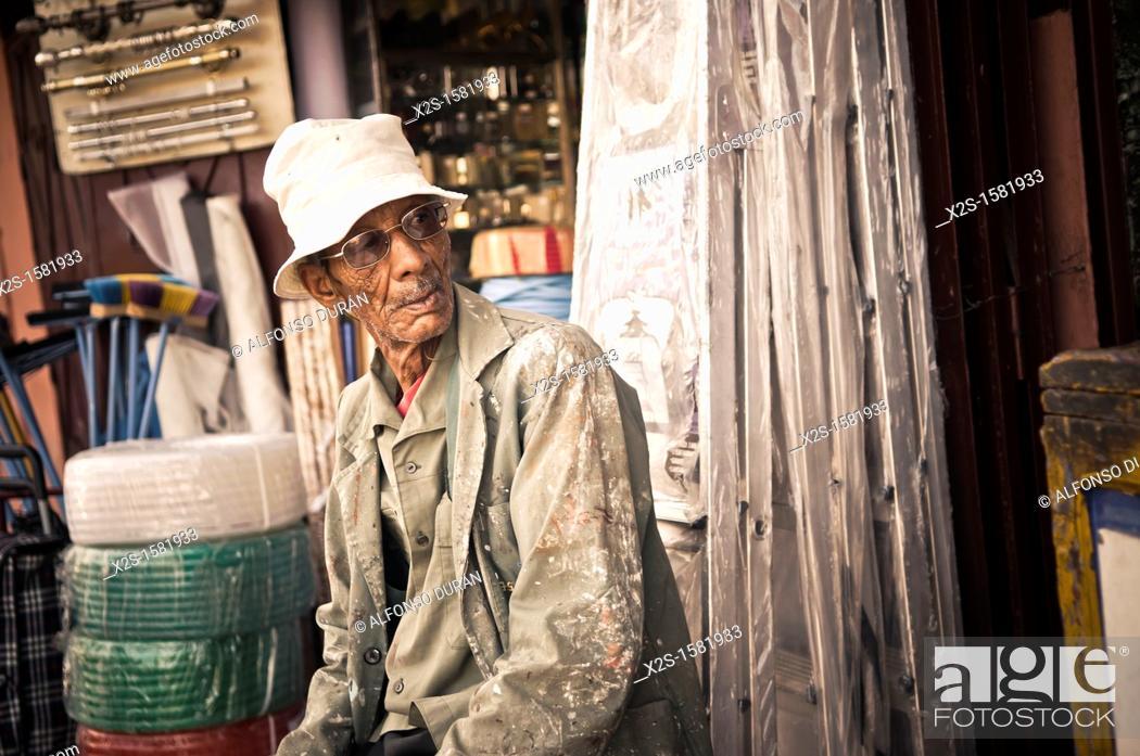 Stock Photo: older man in hardware, Marrakech, Morocco.