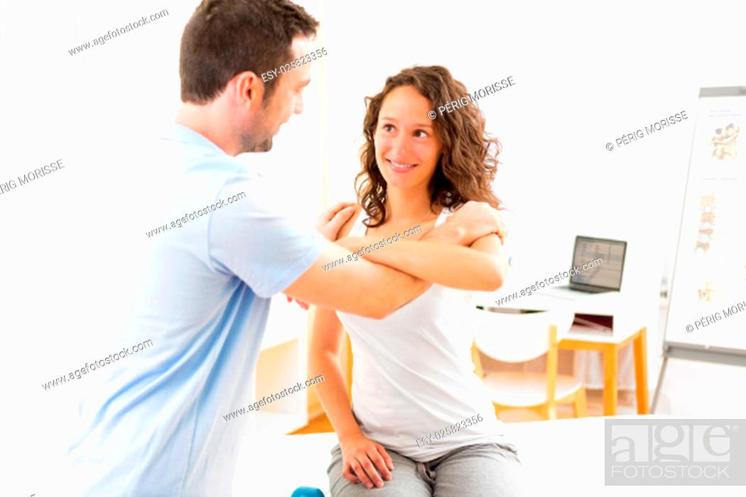 Stock Photo: View of an Young attractive woman being manipulated by physiotherapist.
