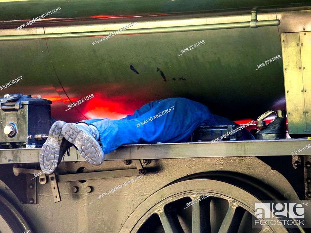 Stock Photo: driver and fireman prepare a locomotive at Peak Rail Steam Railway at Matlock, Derbyshire, UK.