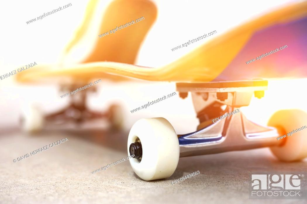 Stock Photo: Close up of a skate board at sunset at the skate park .