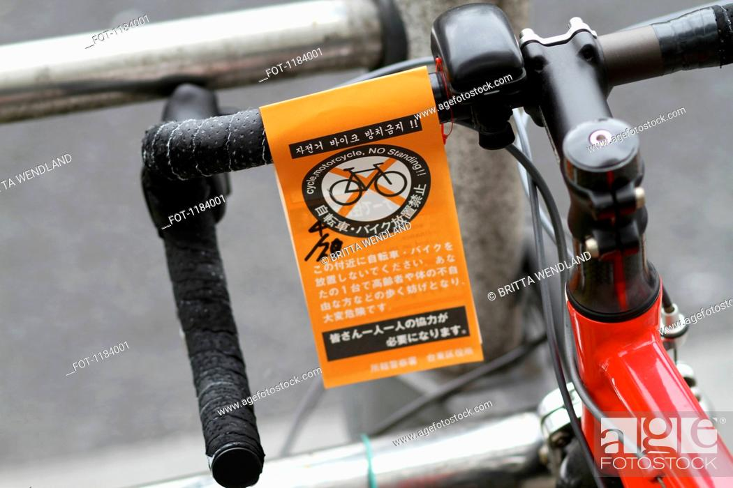 Stock Photo: A No Standing parking ticket for bicycle in English and Japanese.