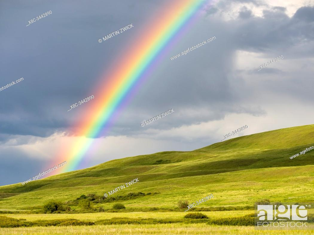 Stock Photo: Rainbow over the Suusamyr plain, a high valley in Tien Shan Mountains. Asia, central Asia, Kyrgyzstan.