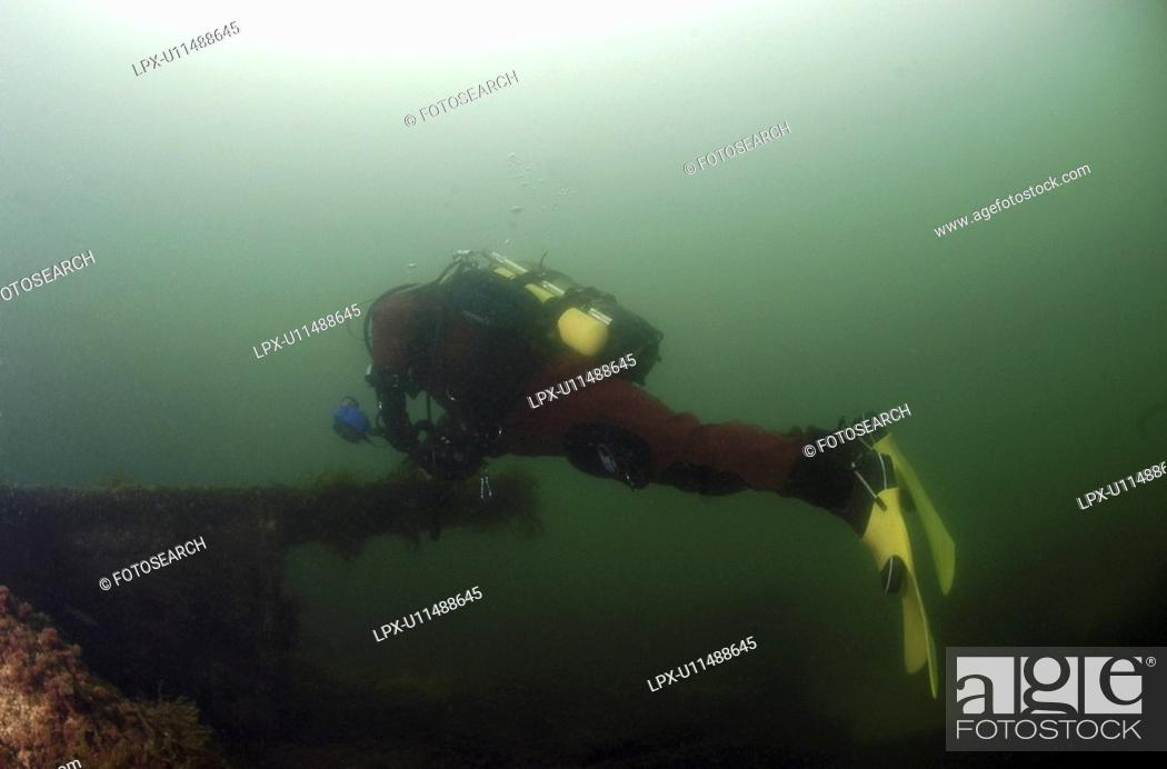 Stock Photo: Diver on British Blockship Ilsenstein, Scapa Flow, Orkney islands, Scotland, UK.