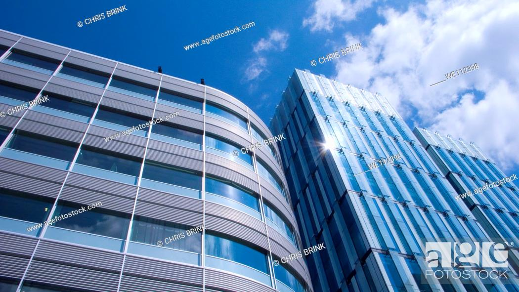 Stock Photo: Sun catching in modern office buildings in Spinningfields, Manchester, England, UK.