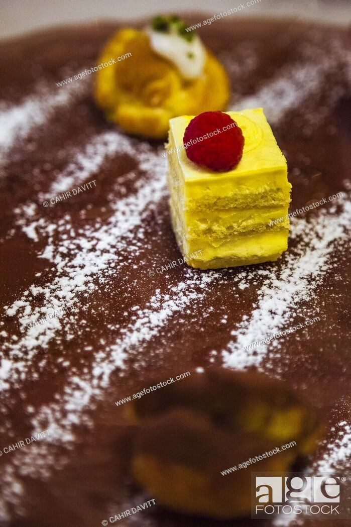 Stock Photo: Italian Dolce desert dish comprising selection of mini cakes served with a chocolate and icing sugar powder, Ghetto Ebraico, Bologna, Emilia Romanga, Italy.