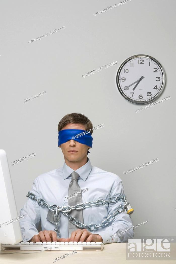 Stock Photo: Businessman blindfolded and chained.