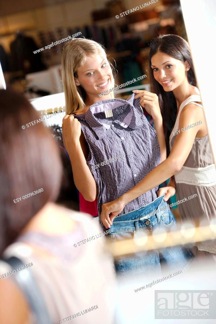 Stock Photo: Young women doing shopping.