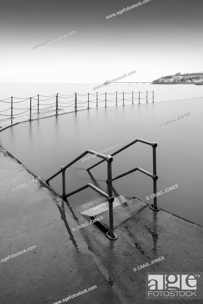 Stock Photo: The Marine Lake at Clevedon with the Victorian pier in the Severn Estuary beyond. North Somerset, England.