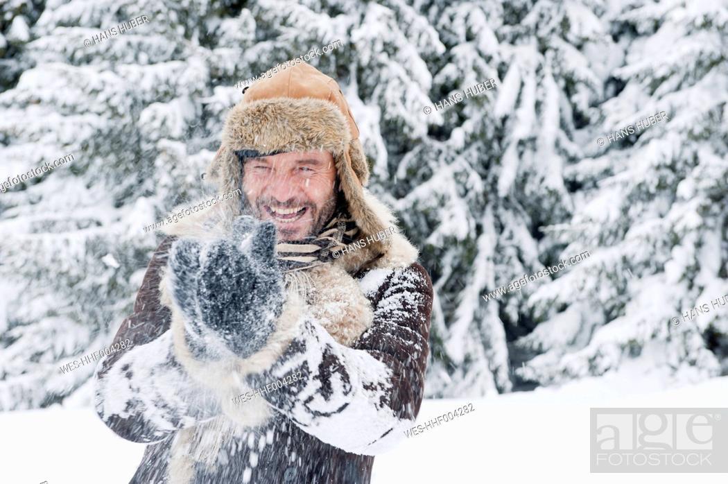 Stock Photo: Austria, Salzburg County, Mature man having fun in snow, smiling.