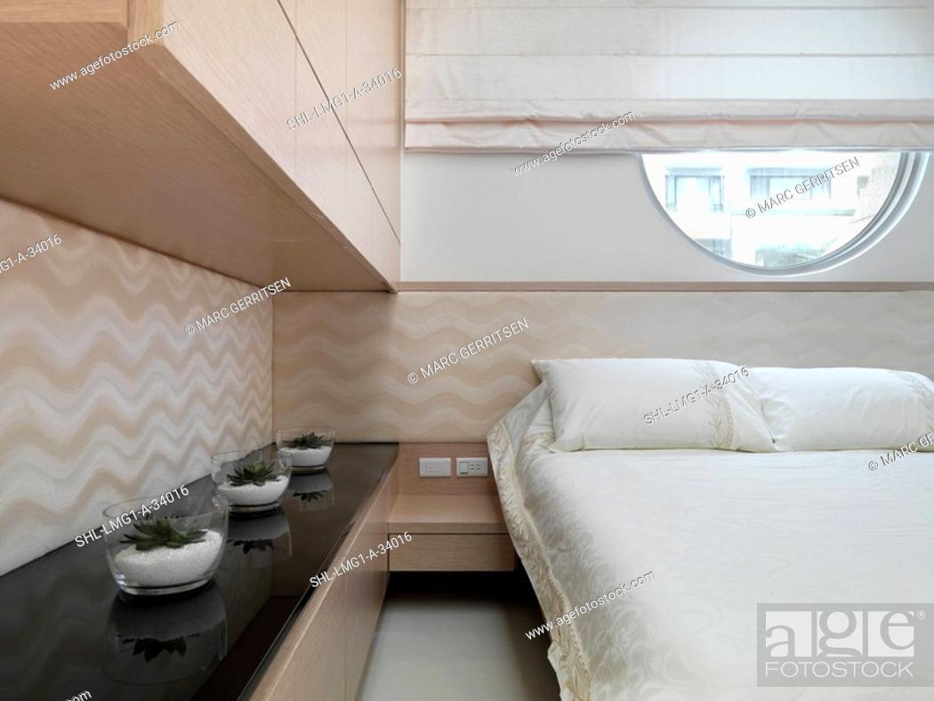 Imagen: Modern bedroom with white bedspread.