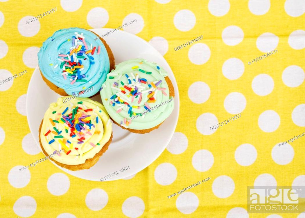 Stock Photo: Cupcakes on Plate.