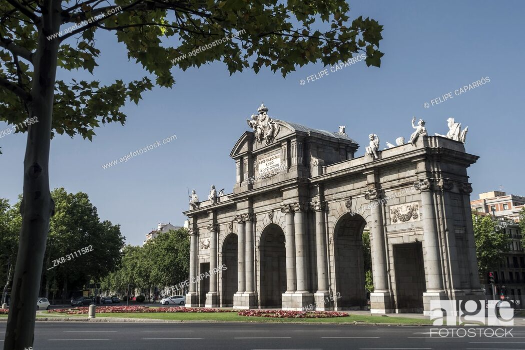 Stock Photo: Madrid, Spain - August 4 2018: Alcala Gate or Puerta de Alcala is a monument in the Plaza de la Independencia in Madrid, Spain.