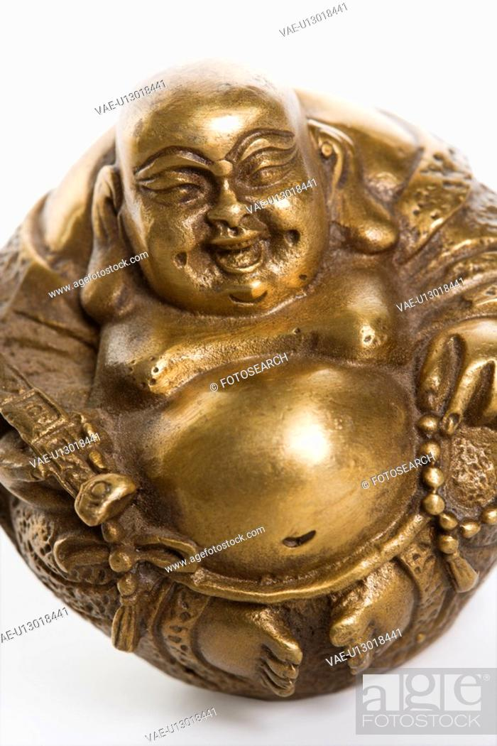 Stock Photo: Happy laughing Buddha brass figurine on white background.
