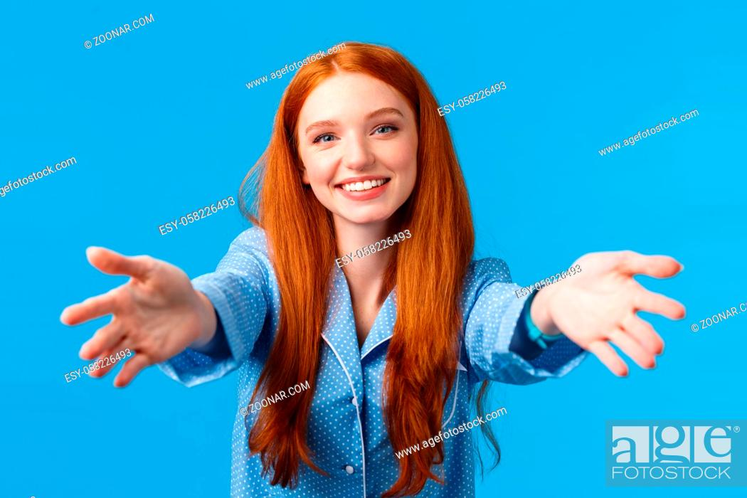 Stock Photo: Let me hold you in my arms. Tender and feminine kind redhead woman reaching forward, stretching hands to hug pillow and sleep.