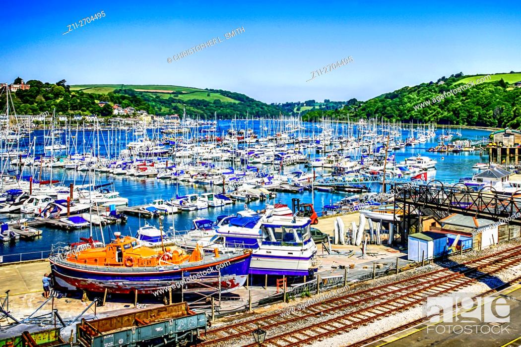 Stock Photo: The River Dart estuary at Kingswear and Dartmouth with its marina and Dart valley Steam Railway.
