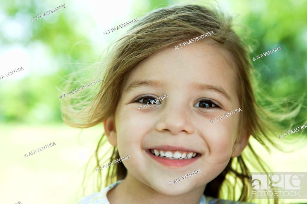 Stock Photo: Little girl outdoors, portrait.
