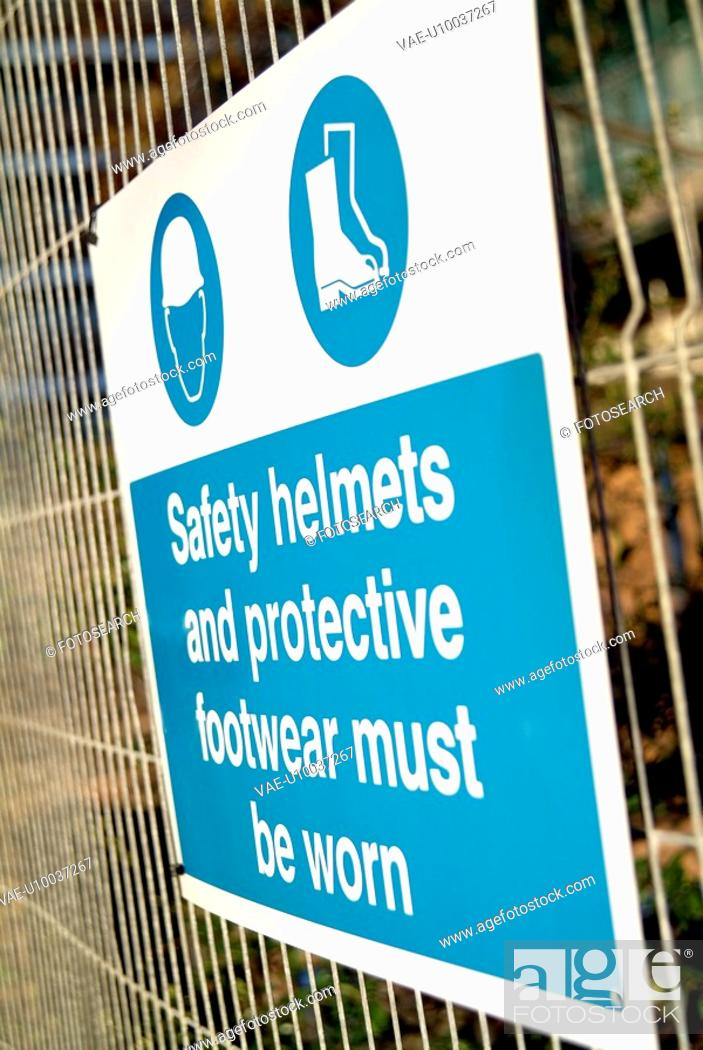 Stock Photo: Safety sign hanged on a fence around a development site preventing public access.