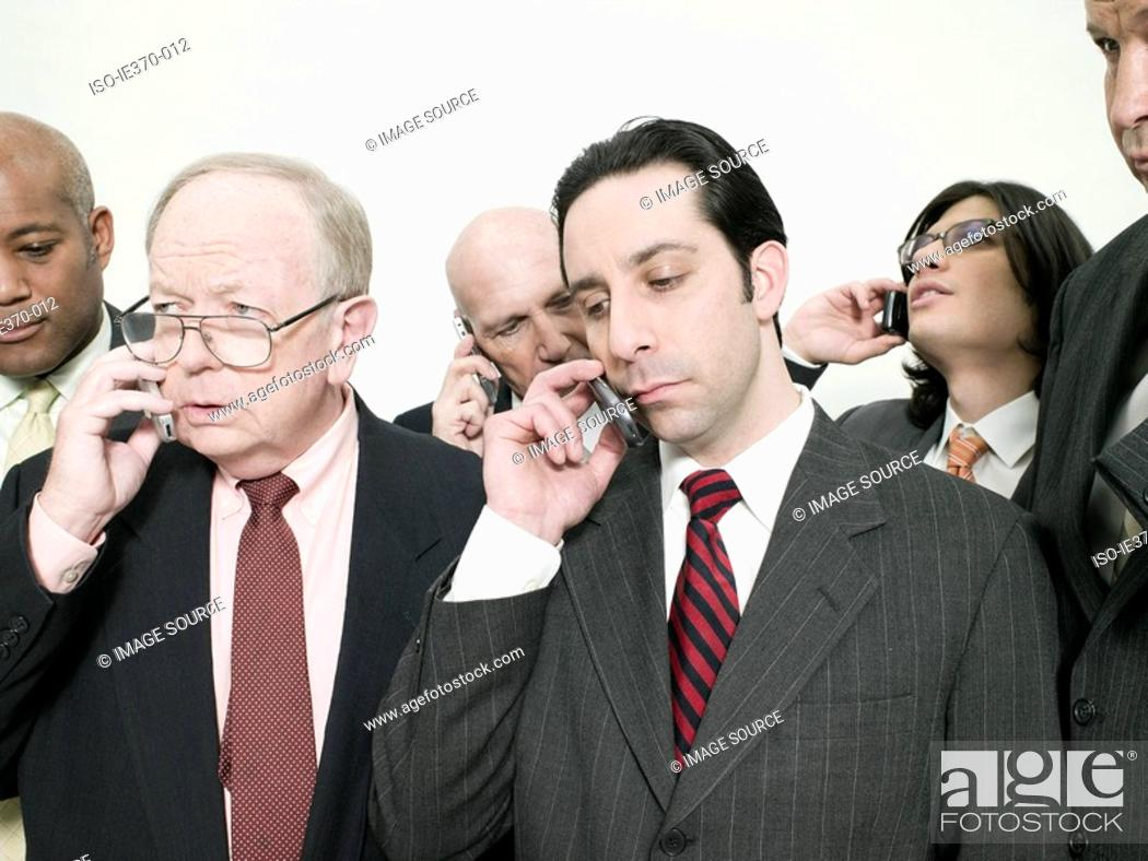 Stock Photo: Businesspeople on cellphones.