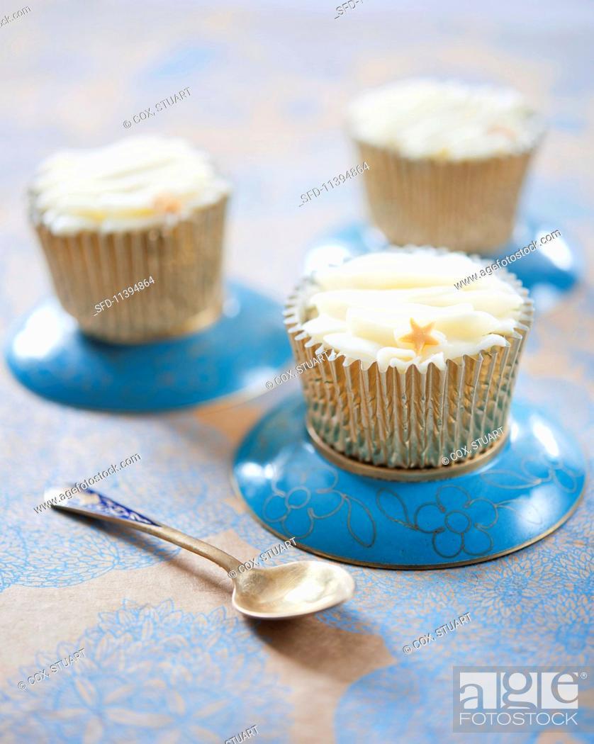 Stock Photo: Vanilla cupcakes decorated with stars.