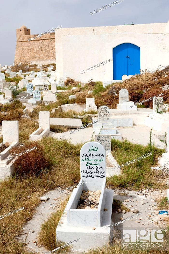 Stock Photo: Tunisia - Madhia - Tombs in the cemetery and in the background the fort.