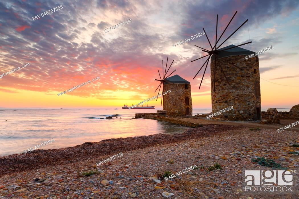Stock Photo: Sunrise image of the iconic windmills in Chios town. .