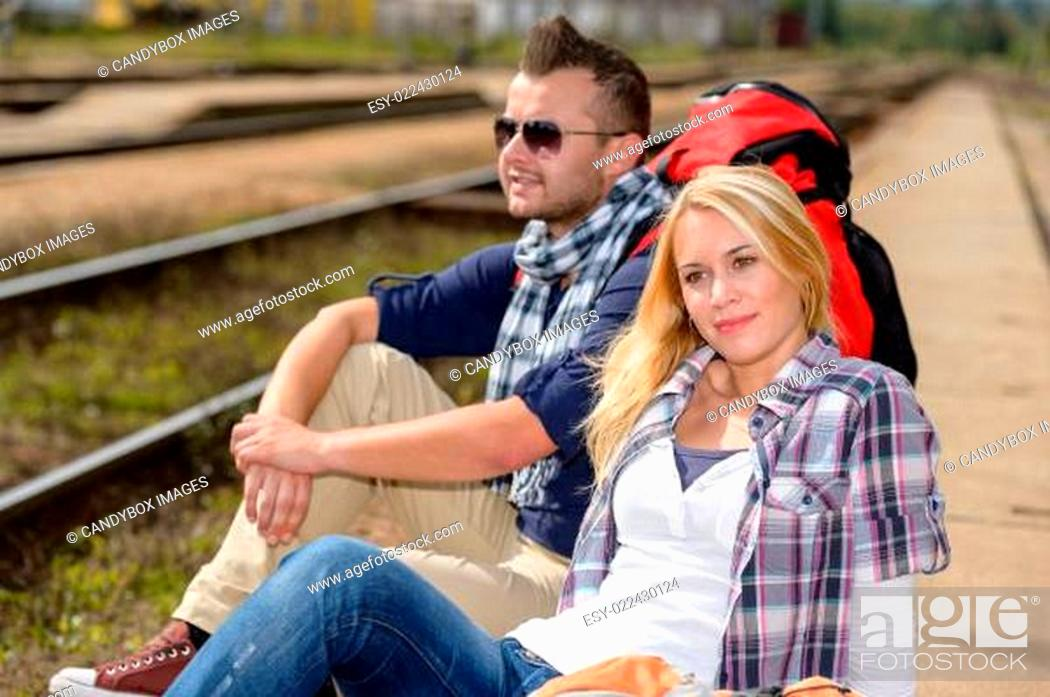 Stock Photo: Couple backpack traveling resting on railroad trip.