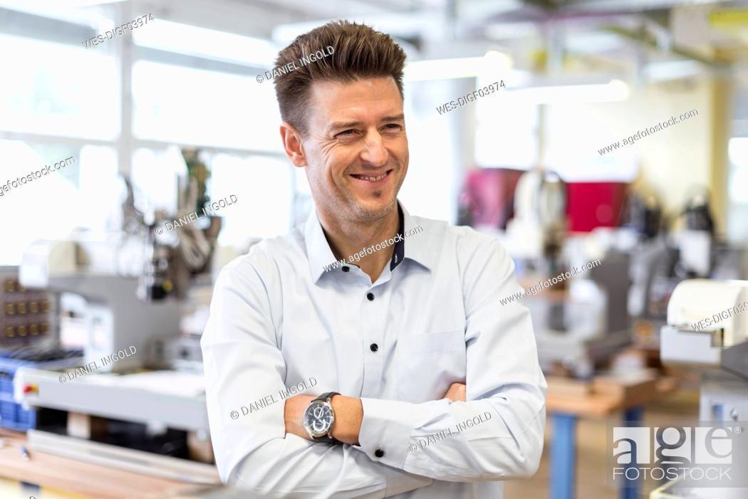 Photo de stock: Portrait of smiling man in factory.