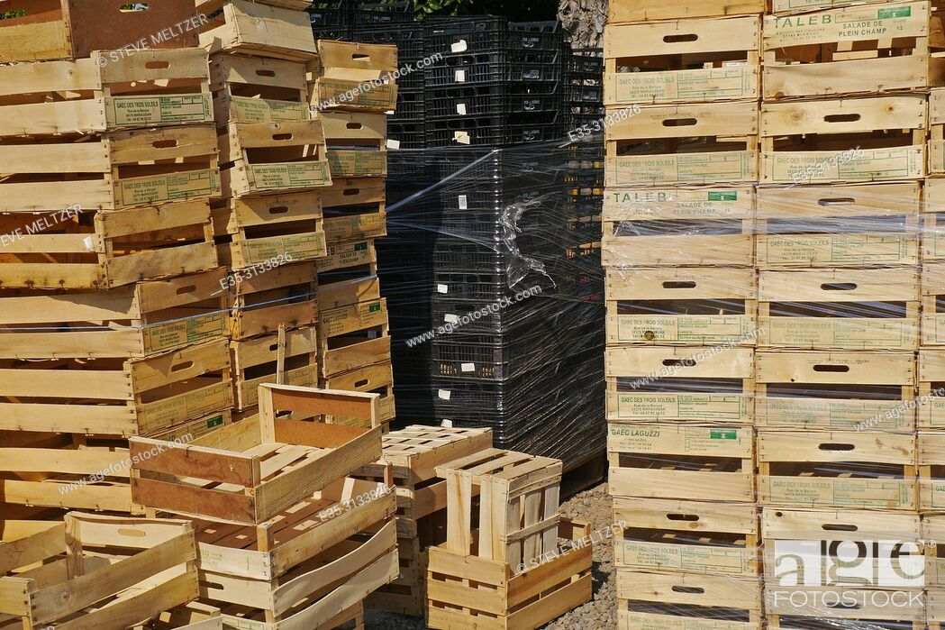 Stock Photo: Stacks of wooden fruit and vegetable crates at a fruit stand.